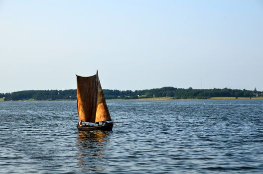Old traditional sailing boat at Roskilde Fjord in Denmark.