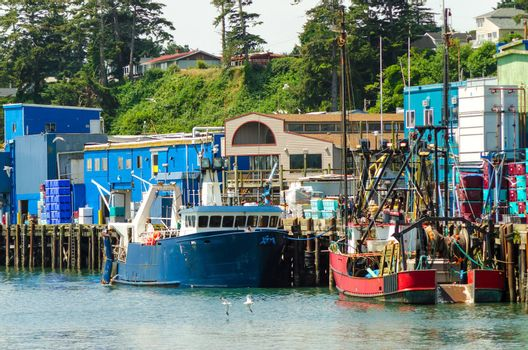 View of the waterfront with old fishing boats in Newport, Oregon