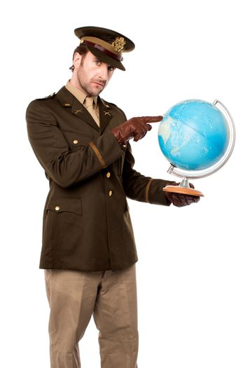 Military officer pointing something on globe