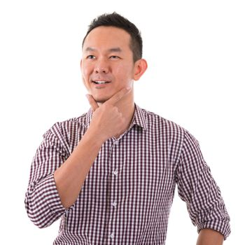 Asian man having a thought