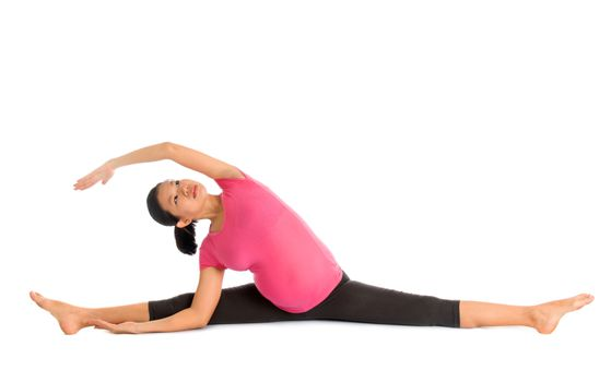Pregnant yoga position seated side stretch.