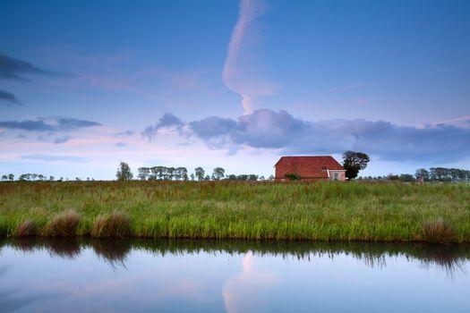 farmhouse by canal in Dutch farmland