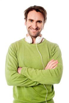 Smart male with headphones around his neck