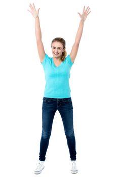 Joyous female raising arms in excitement