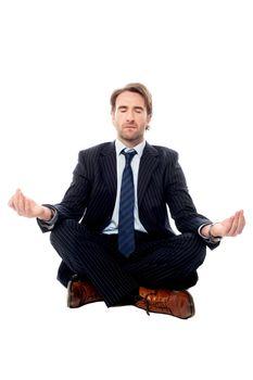 Smart businessman doing meditation