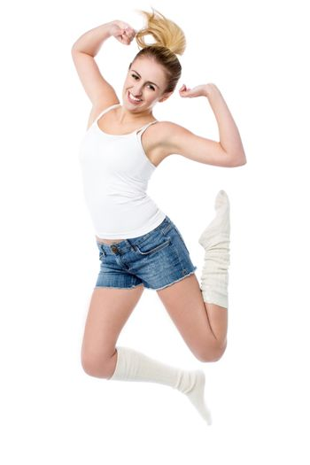 Attractive girl jumping with joy