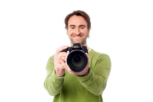 Photographer setting the focus