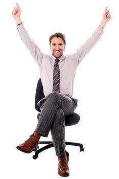 Excited businessman raising his hands