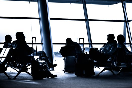 People traveling on airport silhouettes