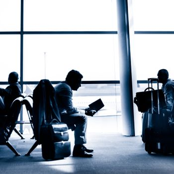 Businessman traveling on airport silhouette.