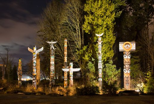 The Totems in Stanley Park Vancouver at night