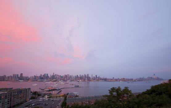The panoramic view of the complete Manhattan Island at sunset from New Jersey side