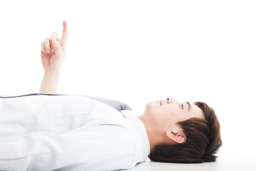 relaxed businessman lie down and pointing up