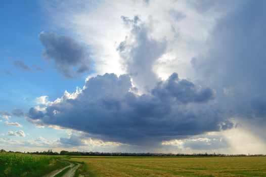 Beautiful Autumn Field under Stormy Sky