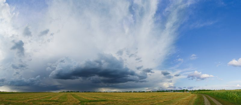 Panorama of the Beautiful Autumn Field under Stormy Sky with Dramatic Clouds