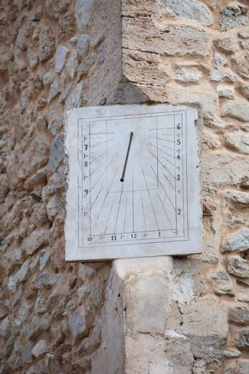 Old clock or sundial