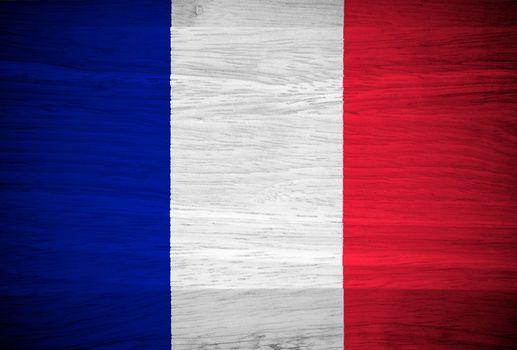 France flag on wood texture