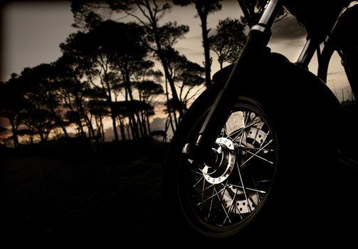 Motorcycle wheel on sunset