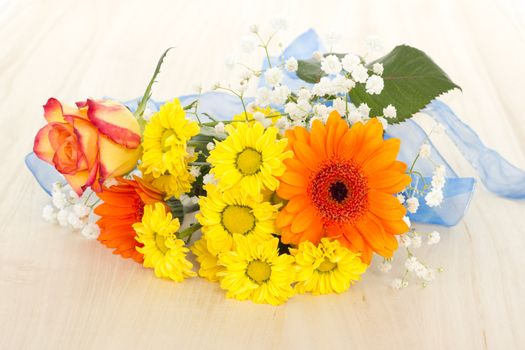 Bouquet of beautiful mixed flowers on wooden background
