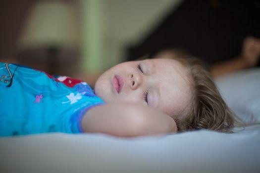 Adorable toddler taking a nap