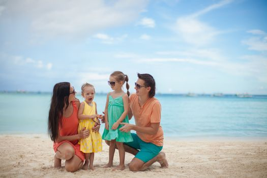 Portrait of a beautiful Caucasian family on tropical vacation