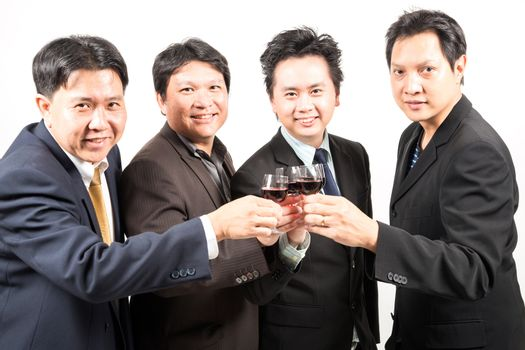 Businessman celebrate with wine for their business success