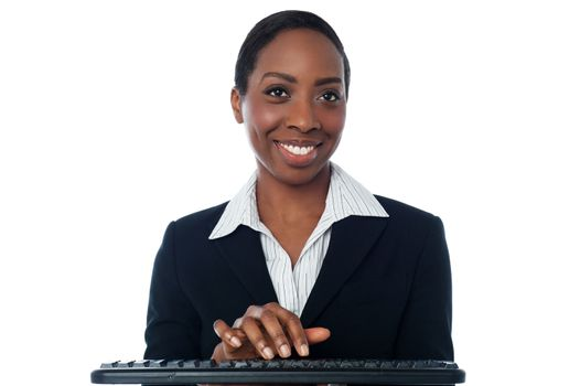 Businesswoman typing on keyboard