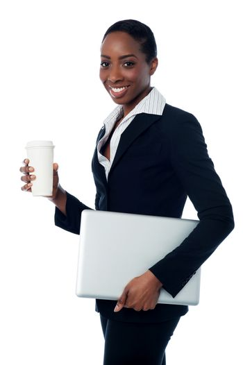 Employer holding laptop and beverage