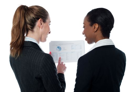 Business ladies reviewing documents
