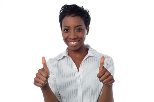 Woman showing double thumbs up