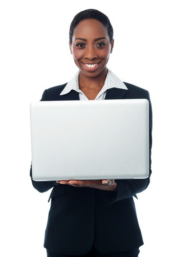 Corporate lady holding brand new laptop