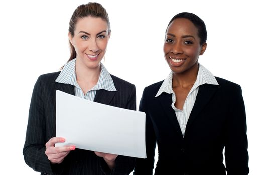 Corporate ladies reviewing reports