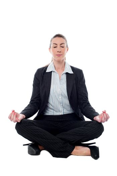 Corporate lady practicing meditation
