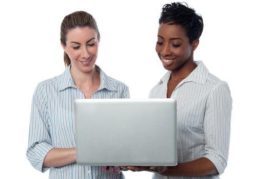 Businesswomen browsing on laptop