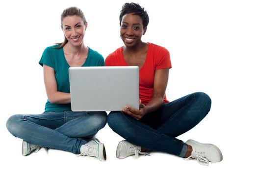 Women browsing on laptop