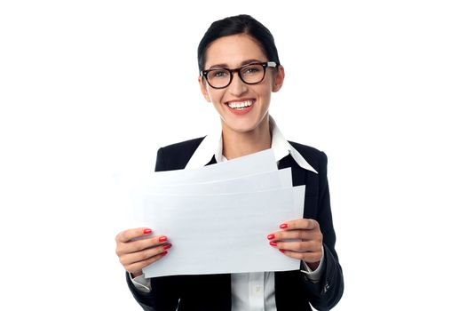 Corporate woman holding business reports