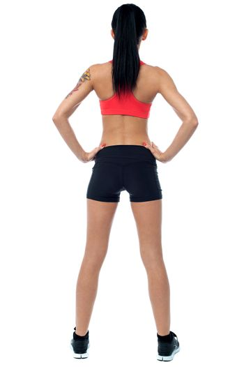 Rear view of a fit slim lady
