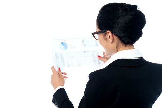 Businesswoman reviewing annual report