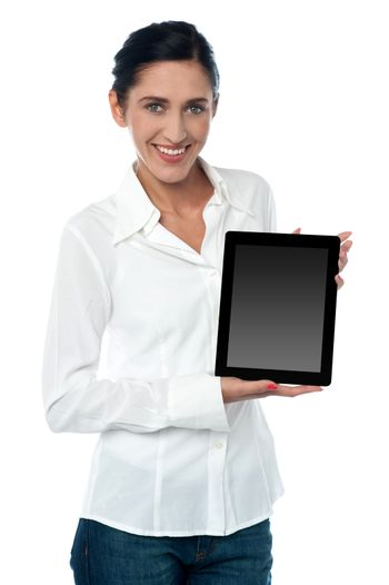 Saleswoman displaying new touch pad device