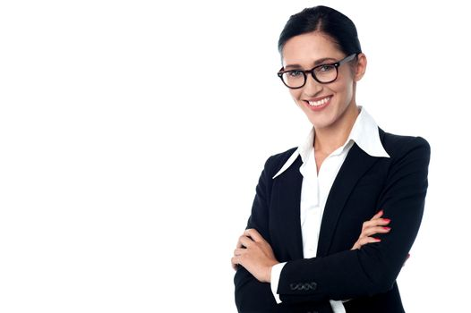 Businesswoman posing with arms folded