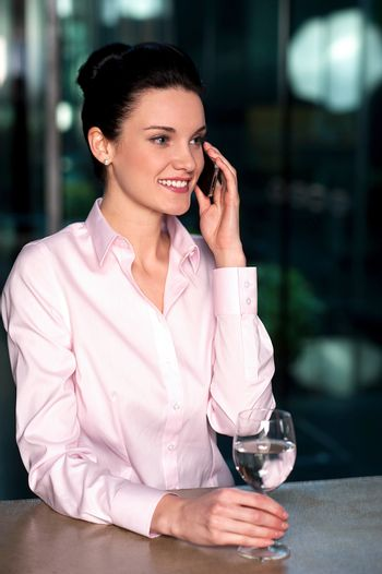 Woman communicating over cellphone to client