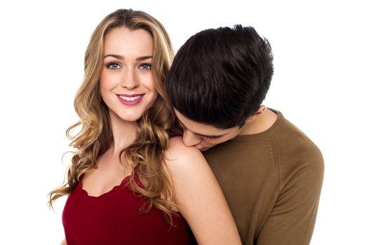Boy kissing his pretty girlfriend