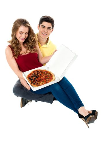 Young boy surprises girlfriend with pizza