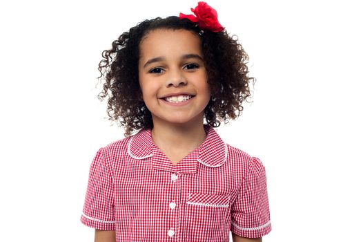 Cute school girl posing in uniform