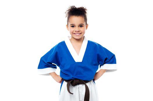 Smiling young karate kid