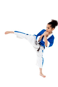 Small kid practicing karate kick