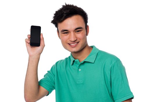Young boy displaying brand new cellphone