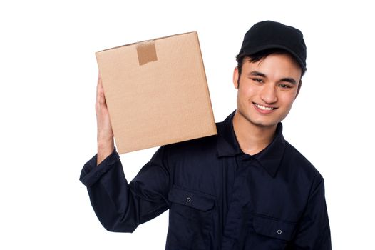 Smart courier boy with parcel on shoulders