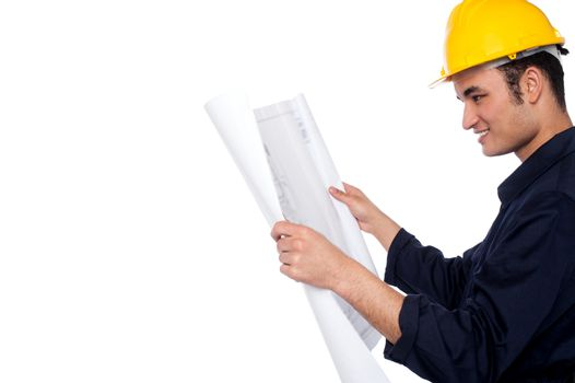 Construction worker reviewing plan