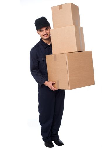 Young courier guy moving boxes